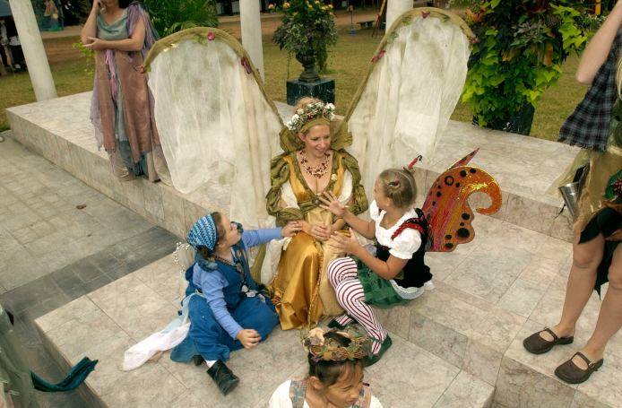 A queen counsels her wee fae in magic.