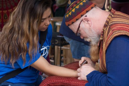 "Kimberly Leiva, student from Navasota High School at the Texas Renaissance Festival on a school day getting a henna tattoo. ""I enjoyed getting a henna tattoo done, it was an amazing piece!"" said Leiva. (1st place, news photo, Carolina Tovar, Navasota HS)"