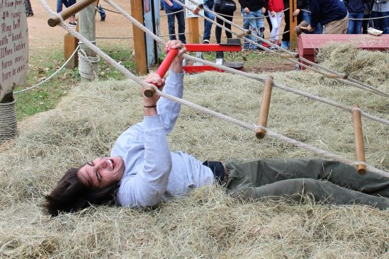 JACOB'S LADDER. Trying his best to make it to the top, senior Kellen Hogan hits the hay again. Ren Fest provides elephant rides, swings, games and amazing food. (2nd place Feature, Banks Jackson, Willis HS)
