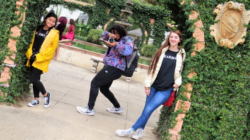 SASSY SENIORS. Willis High School yearbook staffers seniors Emily Warren, Aubri Ford and Jocelyn Dow take a quick pic during Ren Fest School Days. The yearbook staffers attended the festival and competed in the journalism contest. (3rd place, Portrait, Daniela Ambriz, Willis HS)