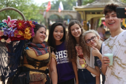 """A group of students share a selfie with a local artisan after purchasing one of her beautiful flower arrangements."" by Derek Song, College Station HS, News Photo, 1st Place"