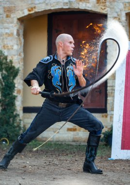"""Adam Crack performs his signature fire trick during the fire whip show at Renaissance School Days."" by Erica Grifaldo, Navasota HS, Action Photo, 1st Place"